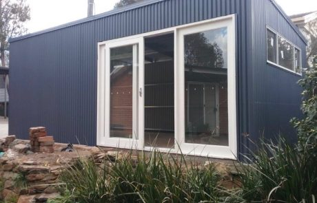 Domestic Garage by Sheds Shade and Turf