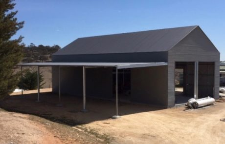Custom farm shed with high pitch roof and 20m x 6m awnings with mezzanine floor